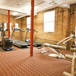 Exposed brick walls set the tone for lofty workouts in this Evanston fitness center.