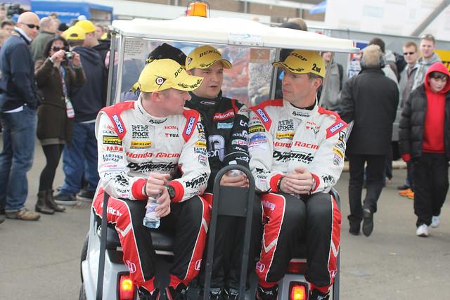 Gordon Sheddon, Matt Neal and Mat Jackson, top three  at the BTCC race at Donington Park in April 2012, arrive at the podium