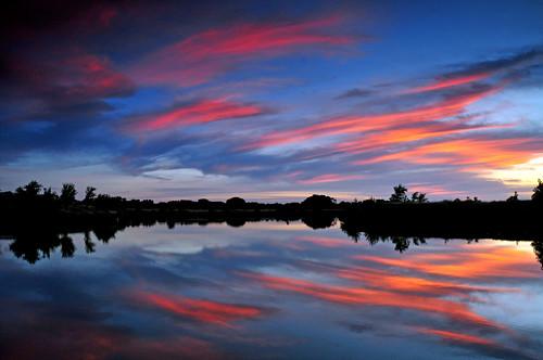 pink sunset reflections kansas wichita chisholmcreekpark