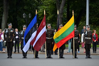 Flags standing at the Baltic Way commemoration ceremony in Riga | by payorivero