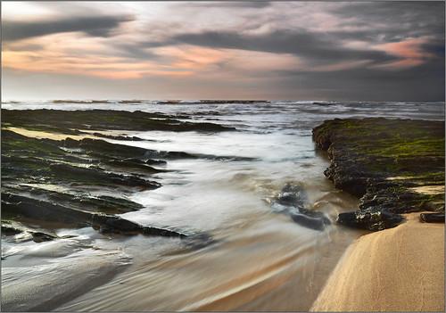 ocean sunset seascape beach portugal landscape nikon rocks atlantic westcoast watermotion monteclerigo zedith zeissdistagont21mm128zf