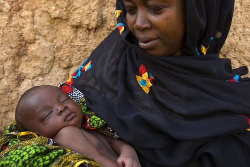 Woman holds a child | by World Bank Photo Collection