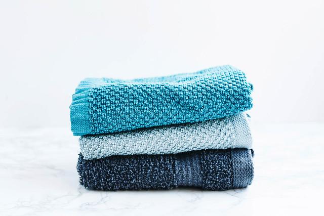 Set of three bath towels on white background