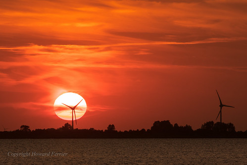 sunset windfarm water germany northsea husum clouds sun tidalflat orange sea coast plain europe windturbine red schleswigholstein de elements scientificbuildings astronomy architecture time