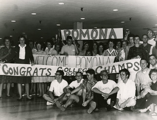 Students wait to welcome home Dallas Holmes '62, David Renaker '63, Richard Wilsnack '64 and Matthew Cartmill '64, after they retired undefeated following their fifth victory on the televised General Electric College Bowl quiz program