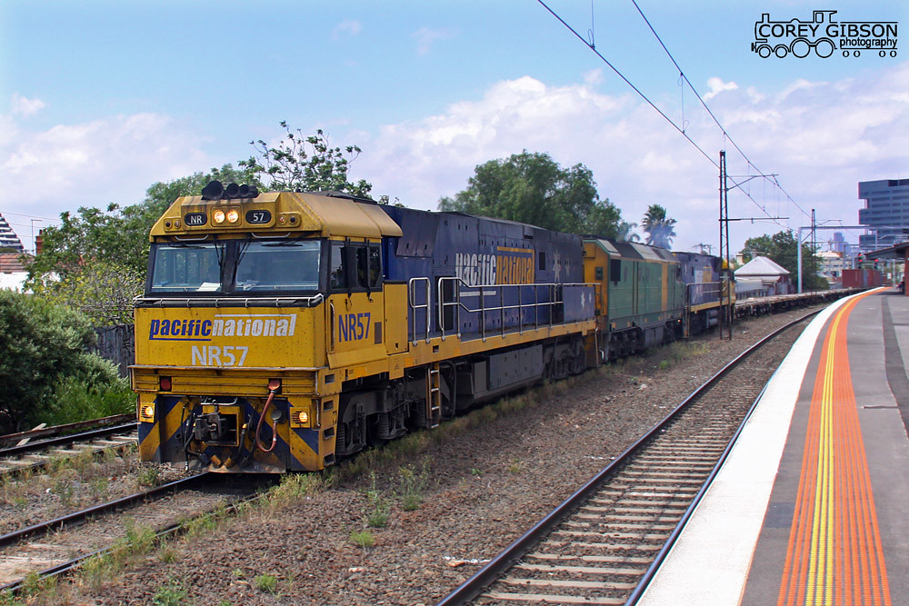 NR57, DL43 & NR88 with the 2MC2 through Middle Footscray Station by Corey Gibson