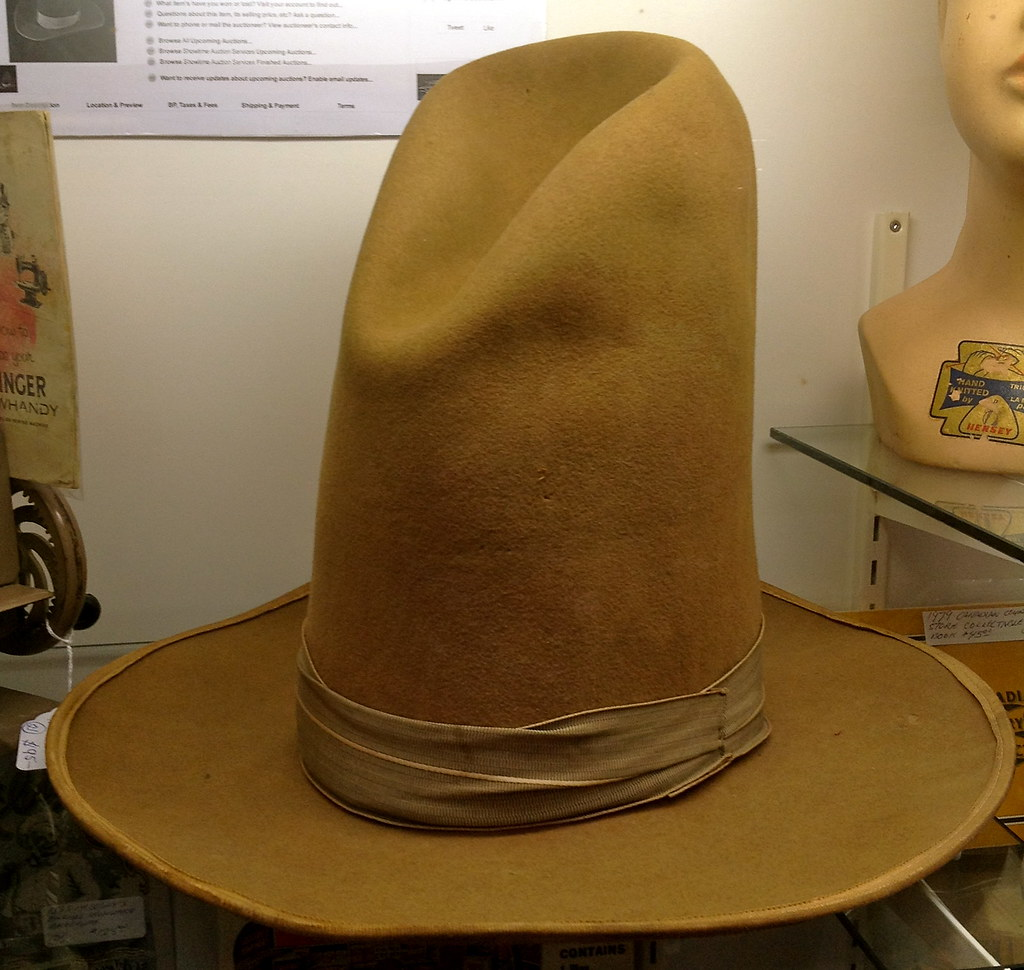 dda58a75ca ... An old fashioned very tall felt cowboy hat was for sale at the Barrie  Antiques Centre