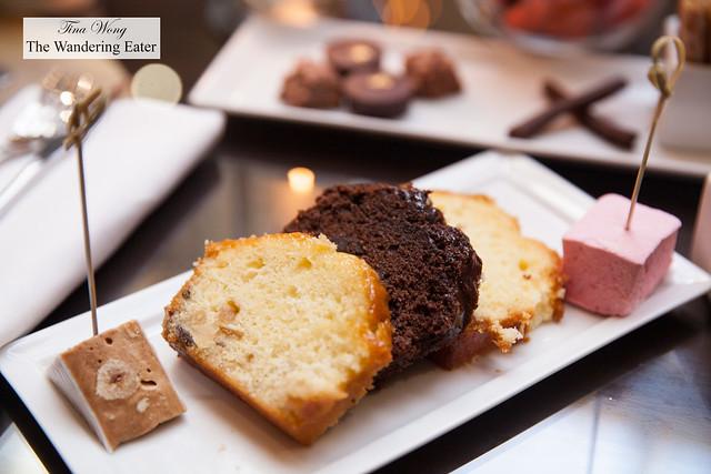 Slices of cakes - chocolate, vanilla cake with glaze and lemon, nougat and strawberry marshmallow