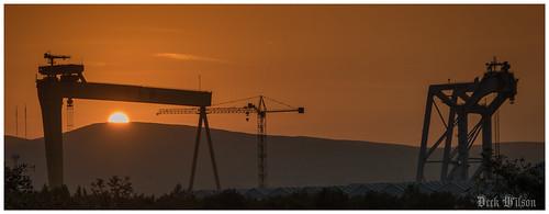 harlandandwolff sunset belfast eveningsunset samsonandgoliath gantrycranes northernireland canon7dmkii sun silhouette orange shadow belfastcityairport