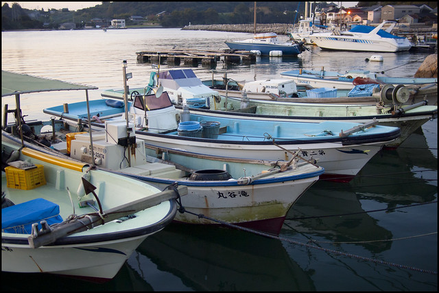 Small fishing boats at sunrise