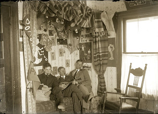 Three Pomona College students in a student room in 1904. It probably isn't on campus as there was no on-campus housing for men at that time.