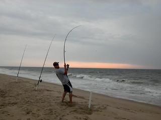 Photo of man surf fishing