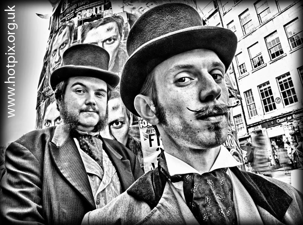 fringe,Edinburgh,2012,2012fringe,fringe2012,city,Scotland,festival,sinister,strange,men,couple,festival2012,b/w,black,white,mono,busker,street,shot,tonysmith,hotpix,UK,Morgan,West,victorian,gents,magicians,waxed,moustache,mustache,beard,facial,hair,face,street scene,street performer,HDR,mono HDR,bandw,extreme,scotia,ecosse,tattoo,august,scenes,capital