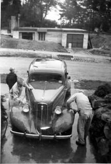 Family washing car, 1960