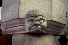 Bradwell font: head wearing a crownlet