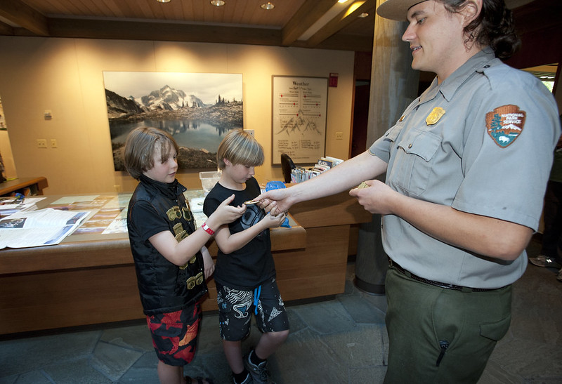 Ranger Ron awards junior rangers with a patch