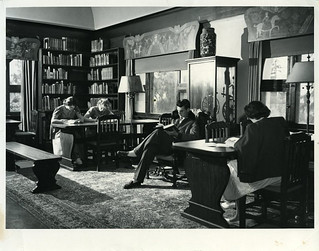 A 1950 Hulbert Burroughs photo of students studying in a room of Carnegie Library, containing pieces from the Westergaard Art Collection