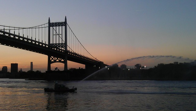 fireboat  In front of the triboro at sunset