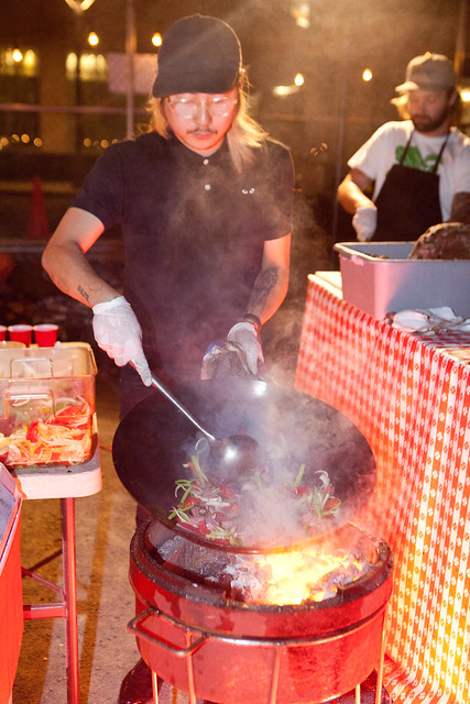 Danny Bowien of Mission Chinese stir frying with his wok