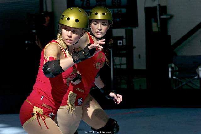 B-Train and Rachel Rotten skate backwards in nice light