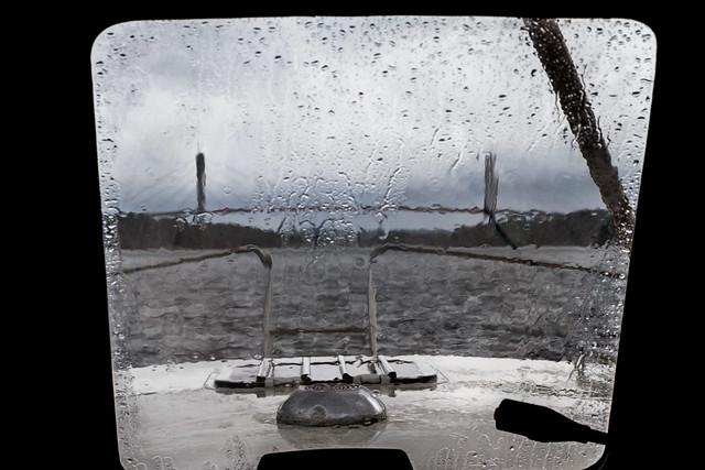 The Tjörn Bridge seen throw rainy window