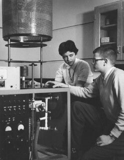Bob Selden '58 and another student using a vacuum system for metal evaporation