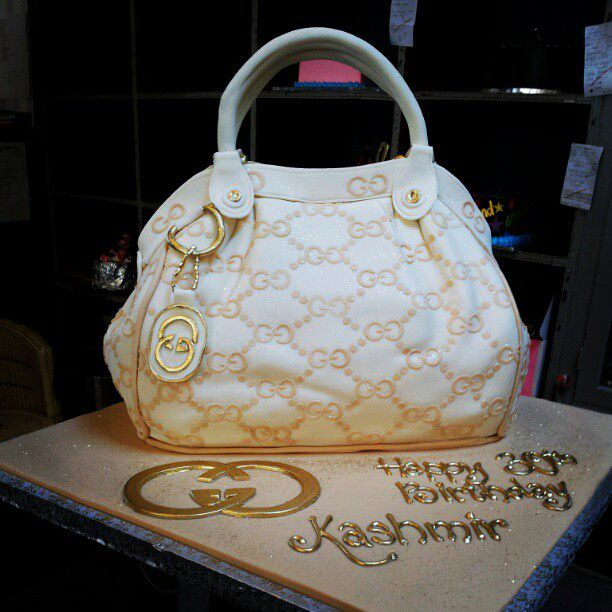 3D Gucci Handbag Shaped Wicked Chocolate Cake Covered In Cream Fondant Icing With Beige Gold
