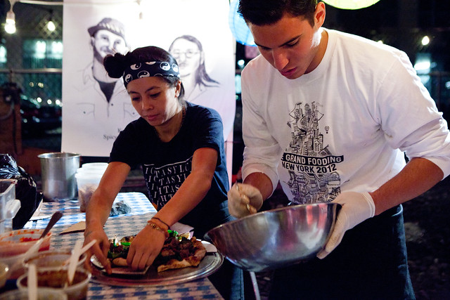 Finishing the pizzas before serving (PizzaMoto & Danny Bowien of Mission Chinese collaboration)