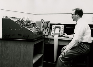 A faculty member works with Pomona's Heathkit analog computer, one of the College's first two computers—one analog and one digital—obtained in 1961.