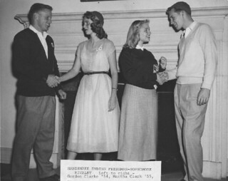 Freshman and sophomore students shake hands, marking the annual end of the year's class rivalry; from left to right: Gordon Clarke '54, Martha Clark '55, Elaine Odland '54, John Jensen '55
