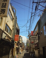 The density of a Japanese city. Back street with scattered power cables and narrow passage between buildings full of small bars. japan #japanese #backstreet #cityscape #japonia #instarchitecture #matsuyama #ehime #shikoku #instalike #instagram #japanesecu
