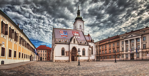 zagreb croatia sky clouds panorama city urban church parliament government square stmarks architecture building cobblestone historic storm weather day morning flag roof tiles spire pointofinterest