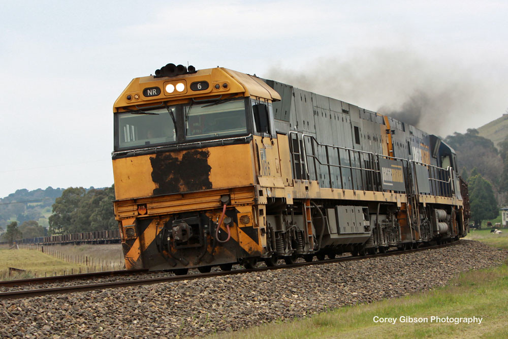 Brown nose NR6 & NR103 work the steel train out of Moss Vale by Corey Gibson