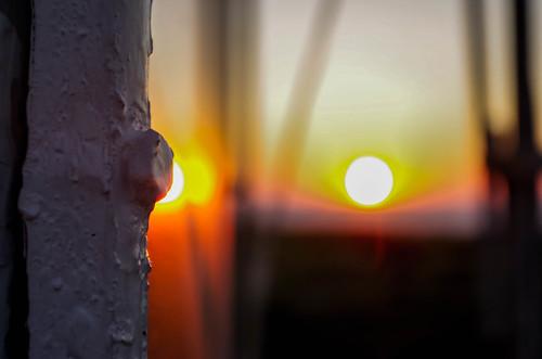 lighthouse sun sundown scape sunset depth field
