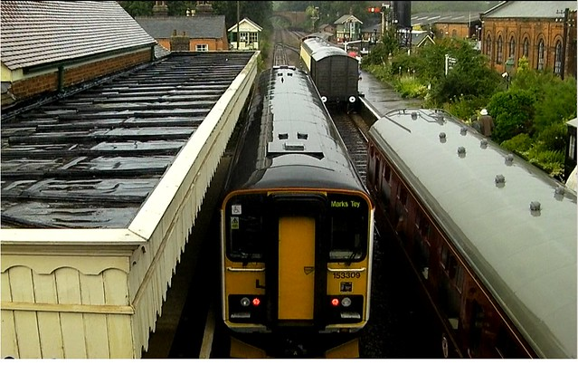 Single Car 153309 at Chappel and Wakes Colne Station, headed for Marks Tey, amid heavy rain.