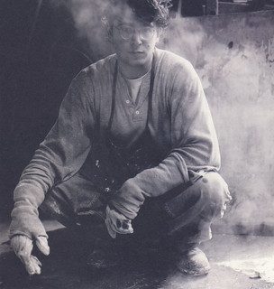 Michael Parker '00 shrouded in steam after working with molten bronze in the sculpture studio in November 1999