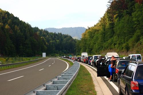 Traffic jam close to border | by dmytrok