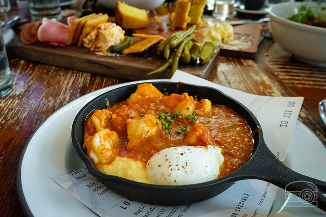 Shrimp & grits - Gulf shrimp, étoufée gravy, grits, and poached egg - Willa Jean