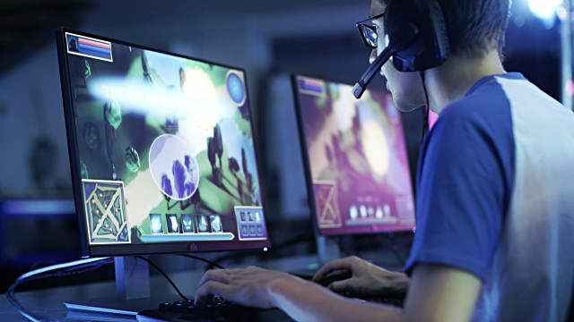 Professional Gamer Plays in MMORPG/ Strategy Video Game on… | Flickr