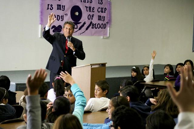Juan speaking with school children