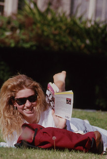 Student reading on the Quad in 1990