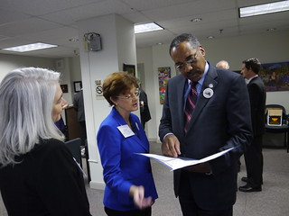 VAM's Margo Carlock speaks with Delegate Matthew James during the Legislative Breakfast | by VAmuseums