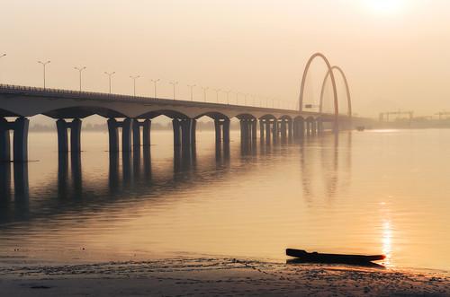 china bridge sunset sun river boat nikon arch footprints shore serene connected tranquil d800 qiantangjiang photonmix laoanphotography