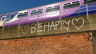 Graffiti on bridge/ railway viaduct  on Manchester inner relief road   by Alex Pepperhill