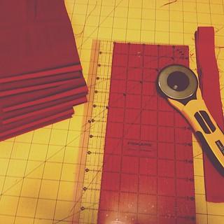 Cutting yards and yards of @robertkaufman Kona Charms for KONA swap, really wish I had a new olfa blade!