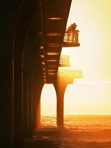 orange photographer aa travel competition top10 silhouette pier sun rays beams sol christchurch newbrighton canterbury newzealand nz gold golden underneath underside jetty light dawn sunrise sunup camera couple digitalcameraclub stevetaylor