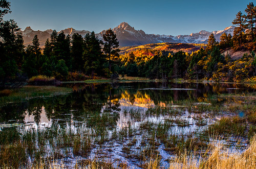 morning autumn lake mountains color reflection fall nature water rural america forest sunrise landscape rockies outdoors pond scenery colorado day seasons unitedstates dramatic icon alpine wetlands aspens jagged telluride rockymountains wilderness peaks sublime drama rugged ridgway sanjuanmountains ouray tranquilscene dallasdivide sneffelsrange coloradogold aspenlined