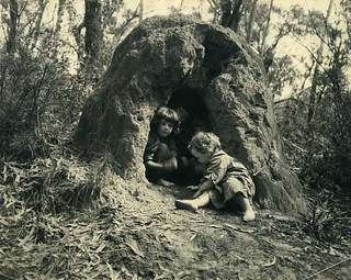 Cazneaux children playing in an anthill