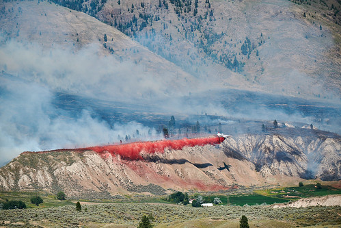 kamloops britishcolumbia airplane fire firefighting waterbomber wildfire colour outside mountain butte