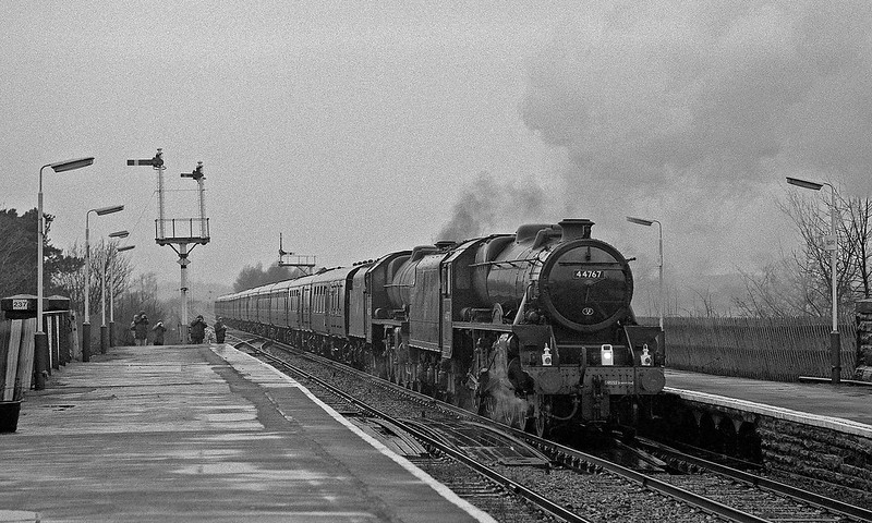 An authentic S & C pairing of Class 5 and Jubilee in authentic S & C weather ! 44767 pilots 45596 into Appleby with a Southbound CME that departed after the water stop at dusk. A few optimistic photographers can be seen braving the conditions but it was rare by this time for people to bother given such a forecast.